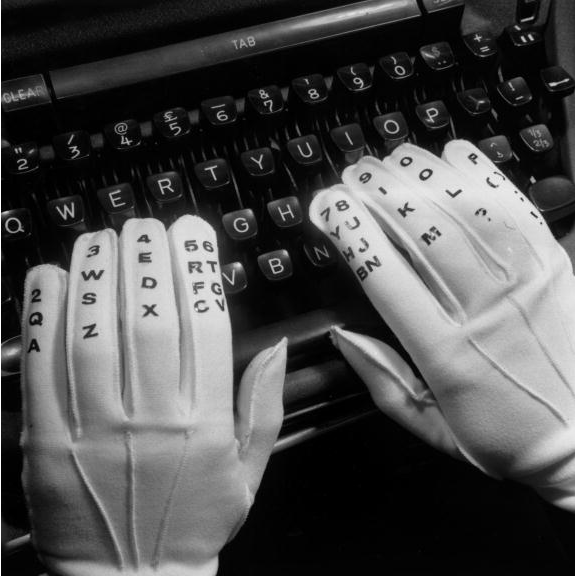 Image result for Specially numbered gloves used to teach touch typing, USA, 1961